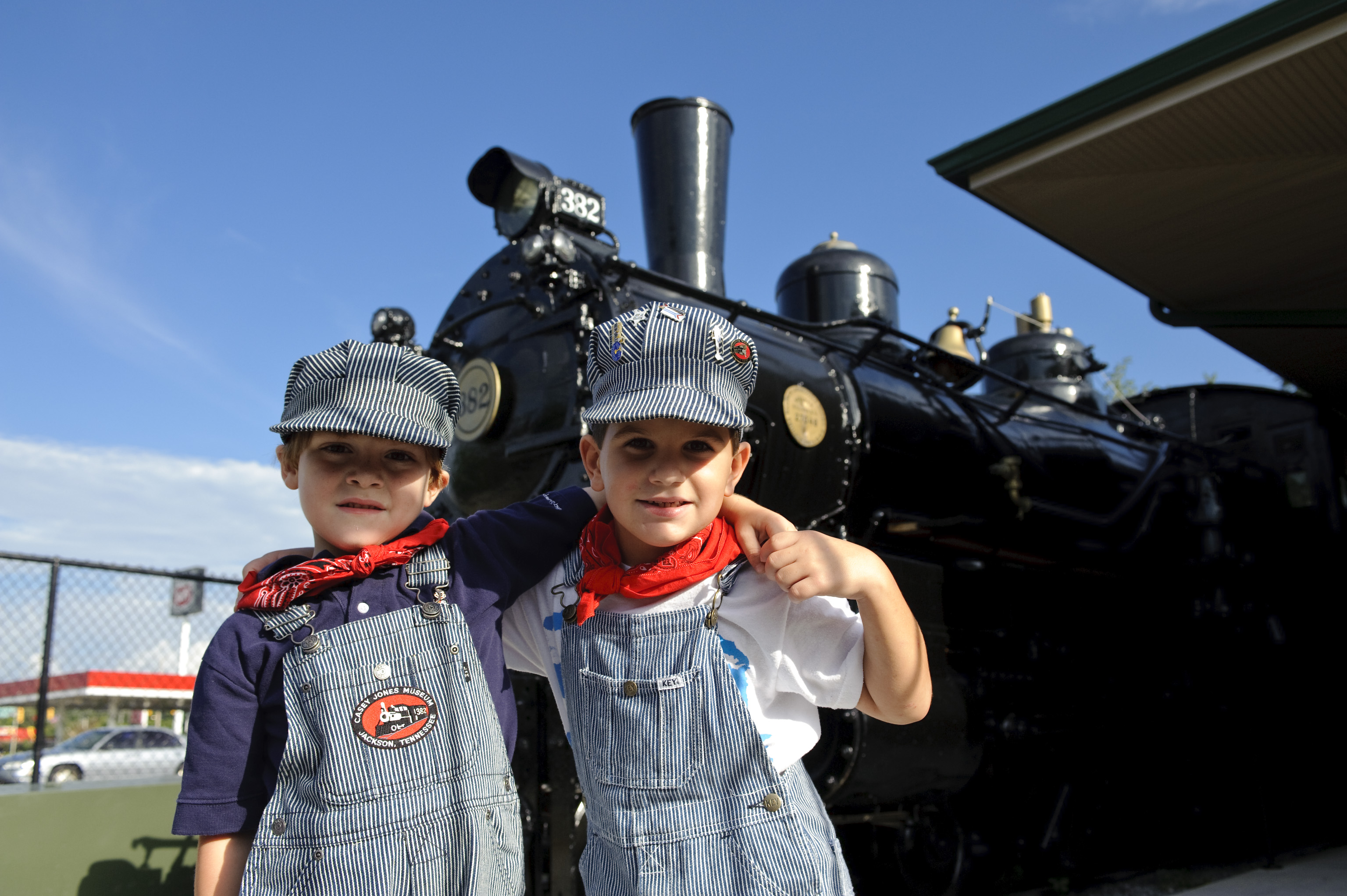 Kids in front of the authentic rail cars on display at Casey Jones Home & Railroad Museum