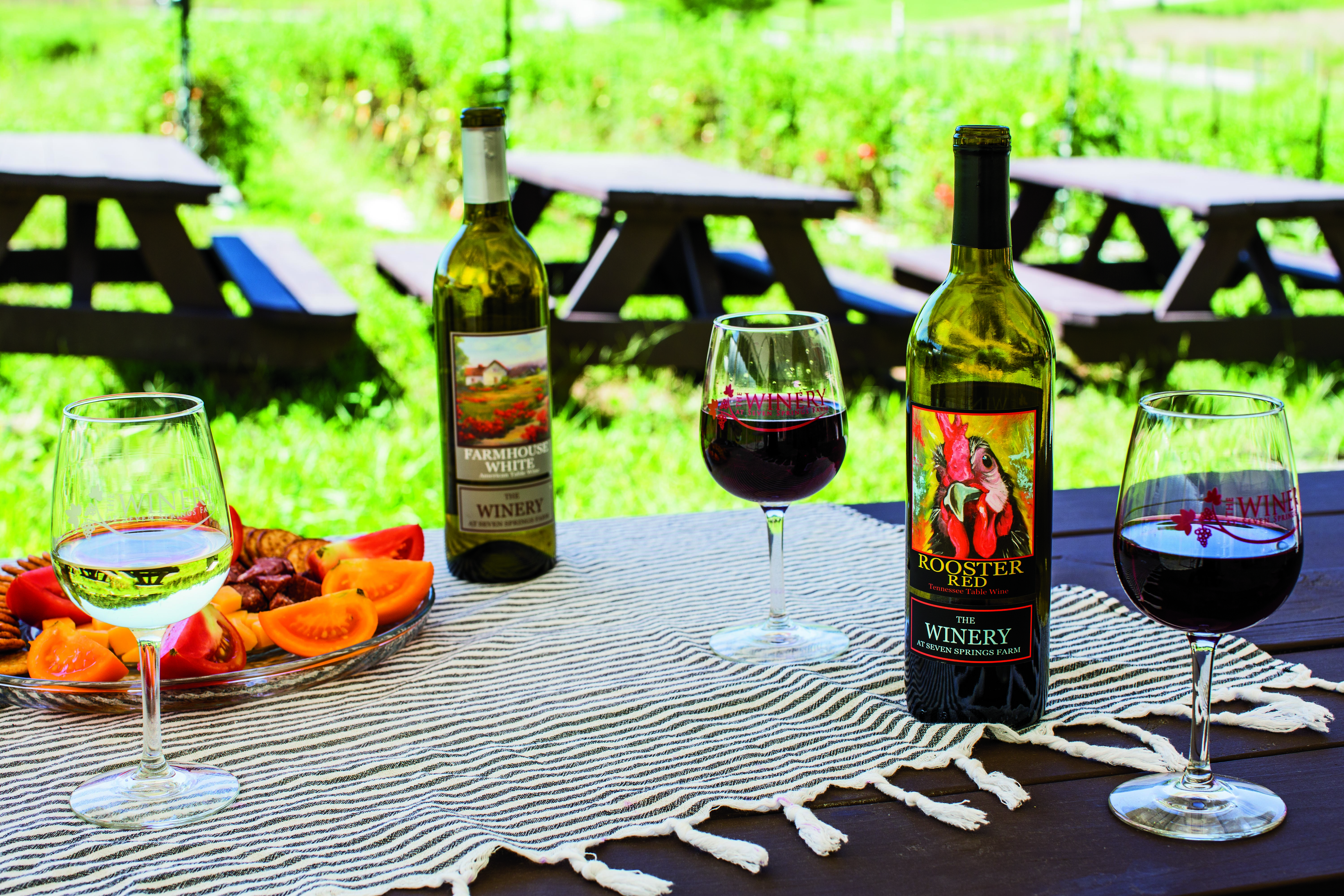 Sip some wine at the Winery at Seven Springs Farm. Photo credit: Andrea Behrends Photography
