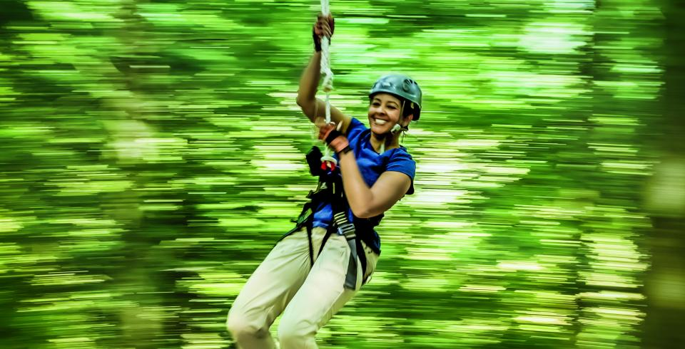 A girl ziplining at Adventureworks in Kingston Springs, Tennessee