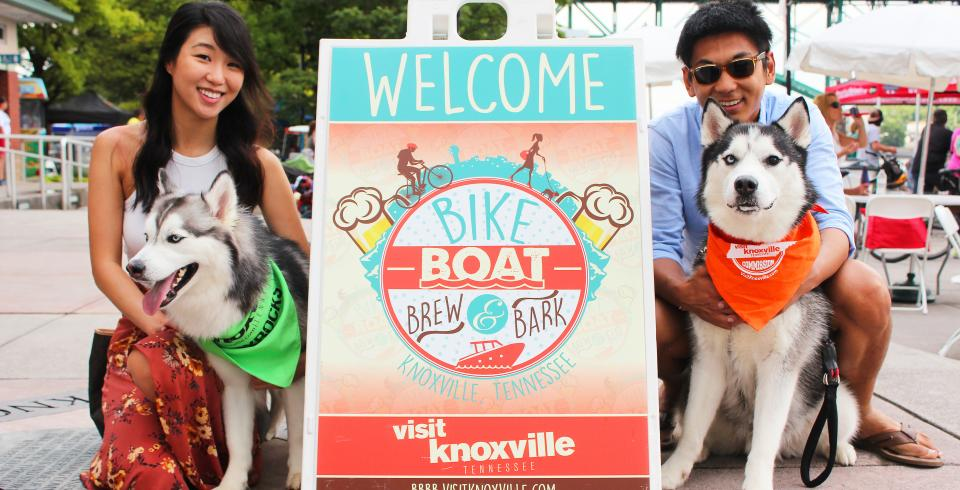 Dogs and their owners at Bike Boat Brew and Bark in Knoxville TN