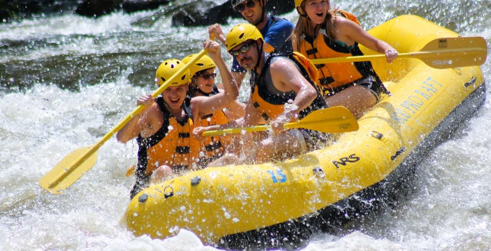 A family whitewater rafting on the Pigeon River in Gatlinburg TN