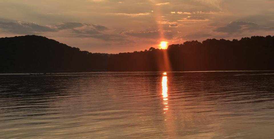 Sun sets at Cordell Hull Lake in Tennessee