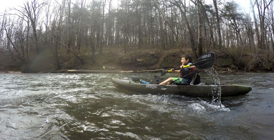 Kayaking along moving rivers