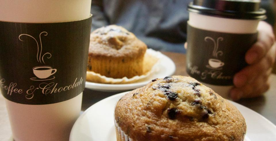 A cup of coffee and chocolate muffin at Coffee & Chocolate in Knoxville