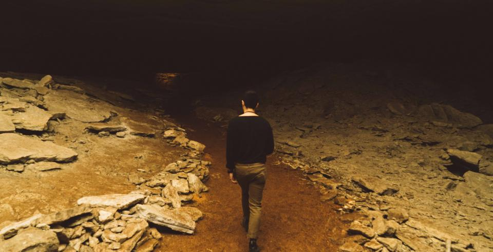A guy walks along the path in Cumberland Caverns
