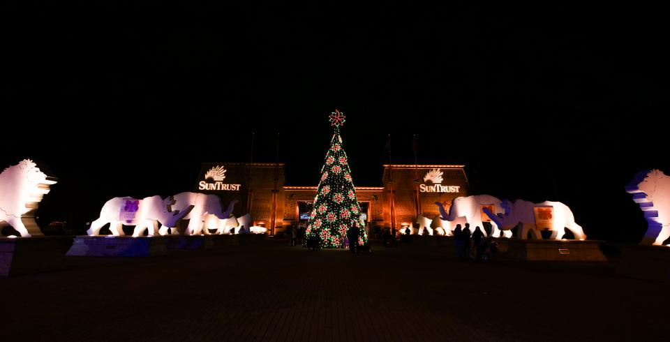A Christmas tree lit up at the entrance of Memphis Zoo.