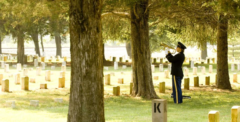 "A soldier plays ""Taps"" at Stones River National Battlefield in Murfreesboro, TN"