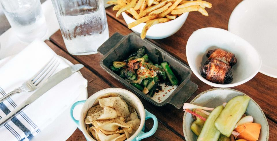 Vegetables, fries, bacon-wrapped dates and other mezze dishes at Butcher and Bee in Nashville Tennessee