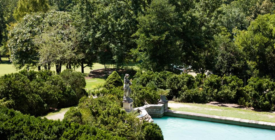 A reflective pool and statue at Cheekwood Estate and Gardens in Nashville