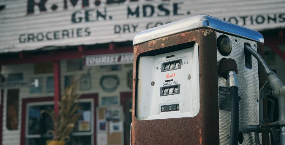 A vintage gas station pump in front of RM Brooks General Store in Rugby, TN