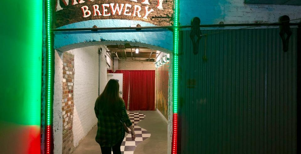 A girl walking into MayDay Brewery in Murfreesboro, TN