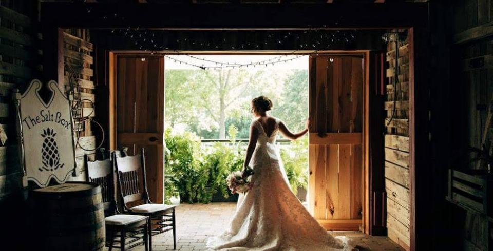 A bride stands in a doorway at Saltbox Inn in Cookeville TN