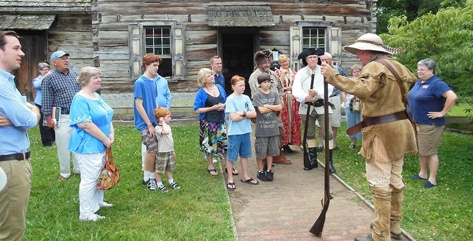 A reenactor shares the David Crockett history at Crockett Tavern Museum.