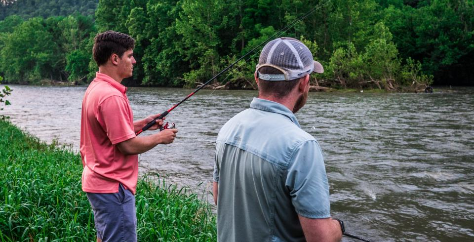 Two guys fishing on the banks of the Clinch River in Sneedville, TN