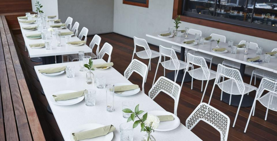 Crisp, white patio seating at The Mockingbird in Nashville
