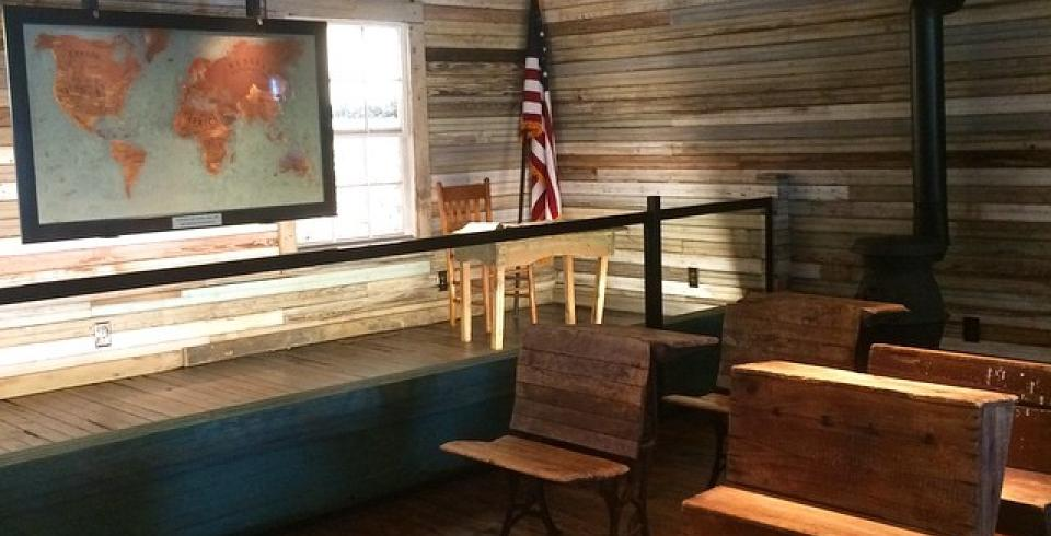 Benches and a map inside the one-room schoolhouse Tina Turner attended in Nutbush, Tennessee