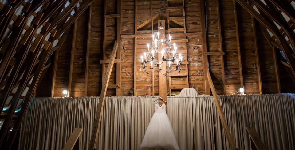 Wedding dress hung up in event space at Pleasant Hill Vineyards in Townsend, TN