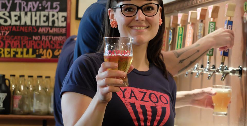 Yazoo Brewing Company bartender offers brew.