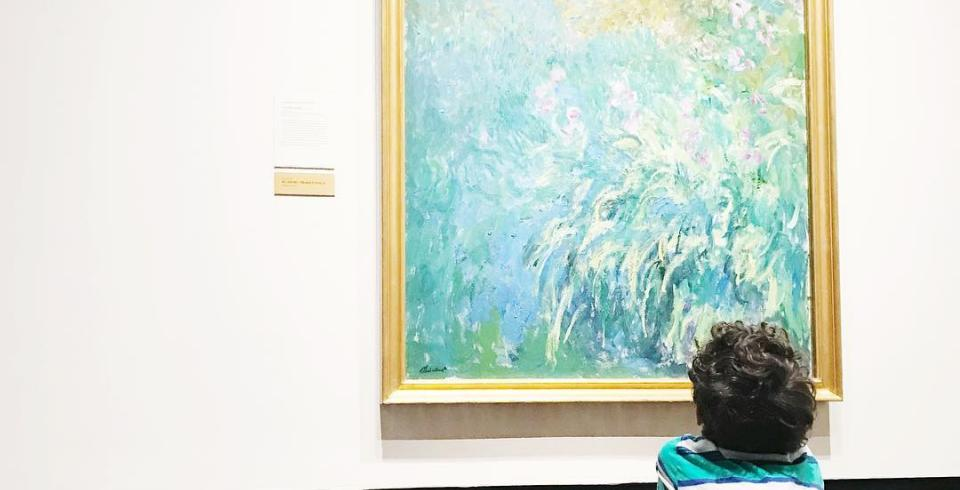 A child ponders art at the Frist Art Museum in Nashville TN