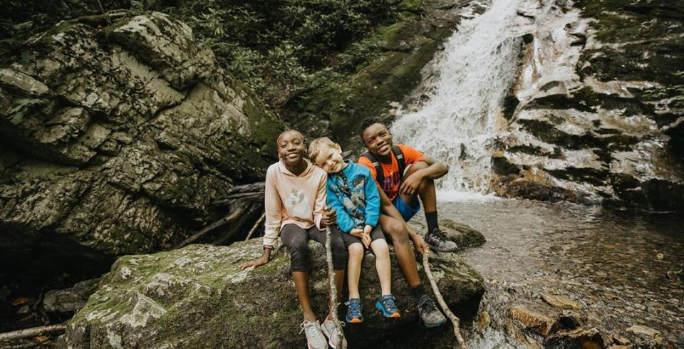 Kids in front of a waterfall at Cherokee National Forest, Tennessee