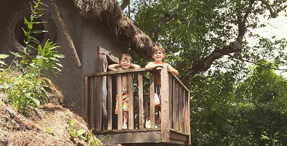 Kids explore a treehouse at Memphis Botanic Garden in Memphis TN