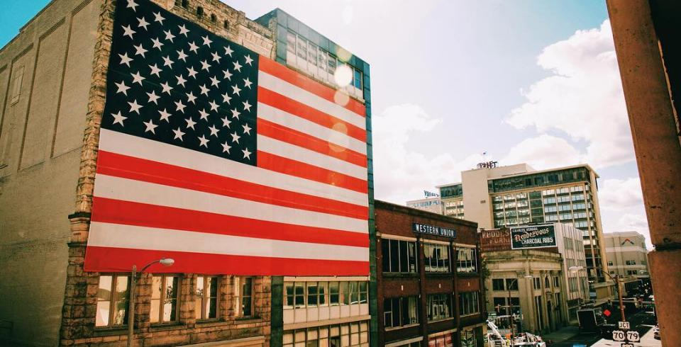 Downtown Memphis with giant American flag on historic building