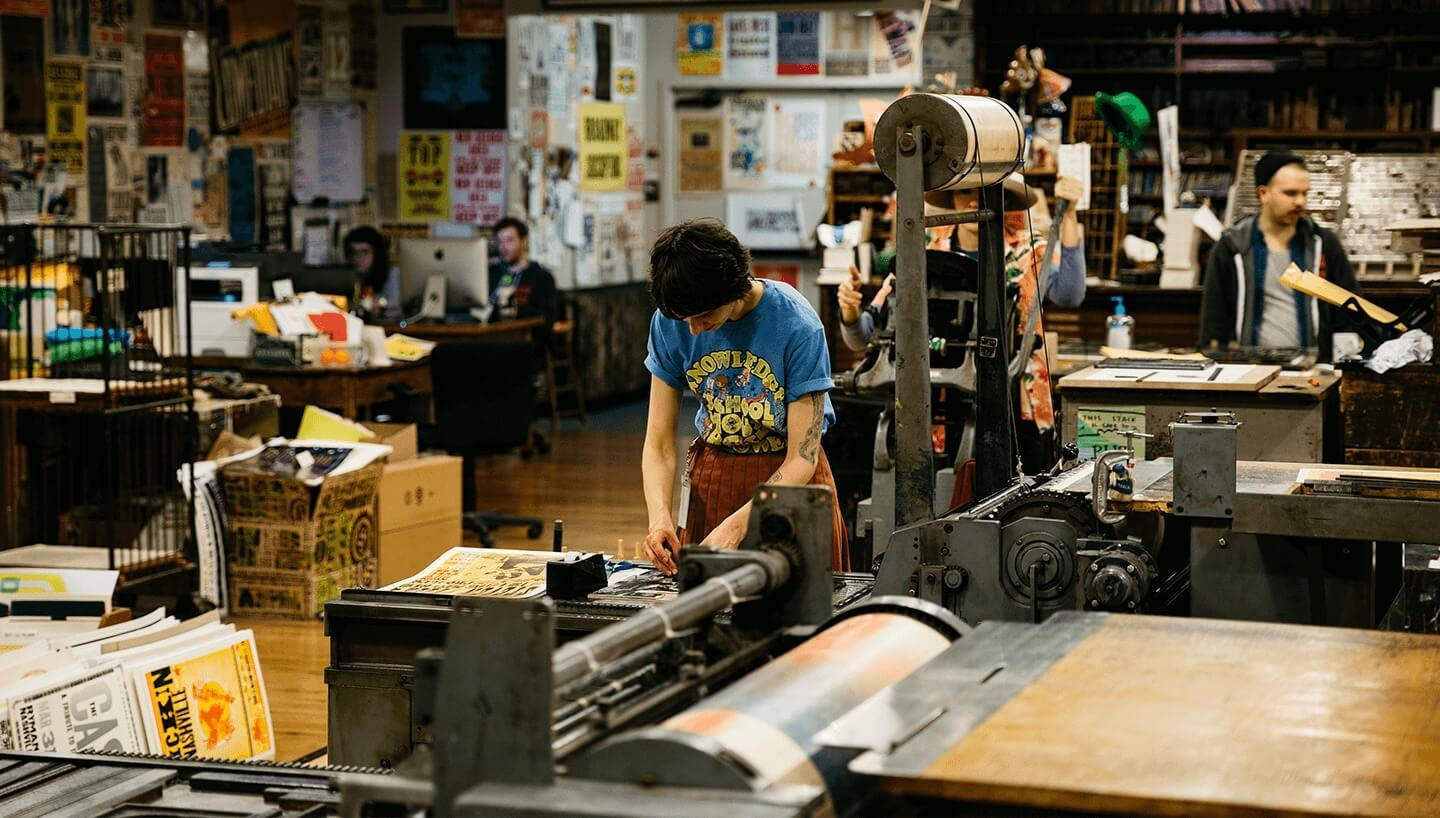 A girl works on printing at Hatch Show Print in Nashville TN