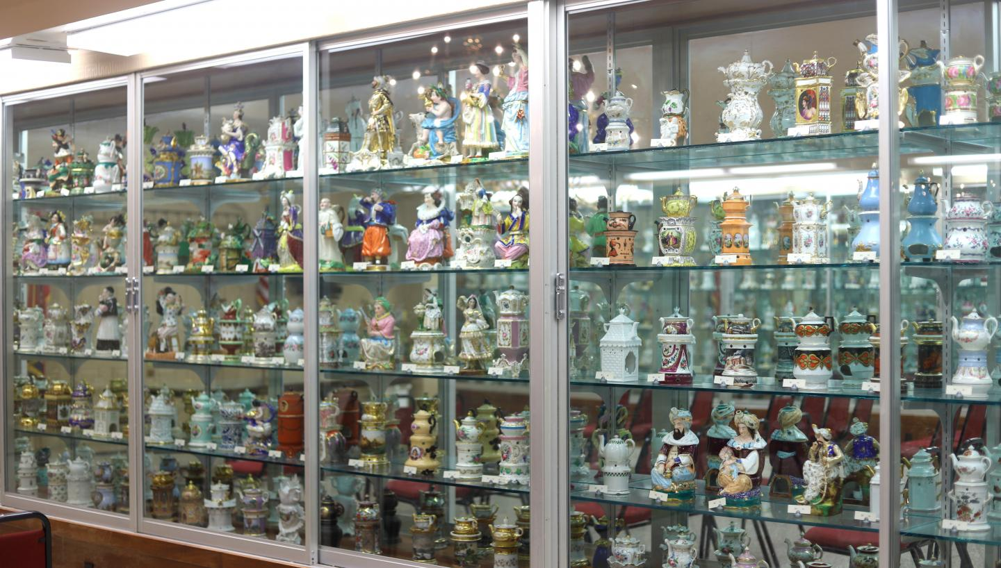 A large display case of Veilleuses-Theieres – teapots featuring figurines in Trenton, Tennessee