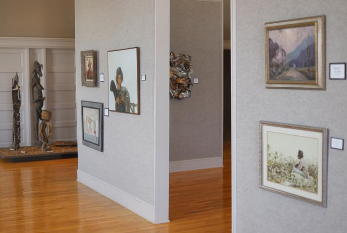 Various paintings and sketches framed on display walls at West Tennessee Regional Art Center