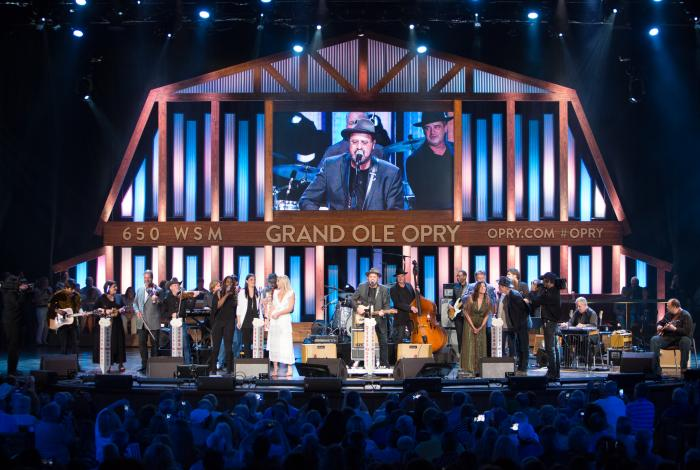 Artists singing on the stage of the Grand Ole Opry in Nashville Tennessee