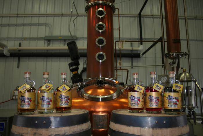 The copper still and whiskeys from Southern Pride Distillery