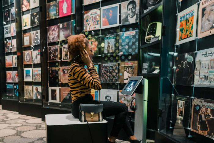 A girl listens to records at Stax Museum in Memphis TN