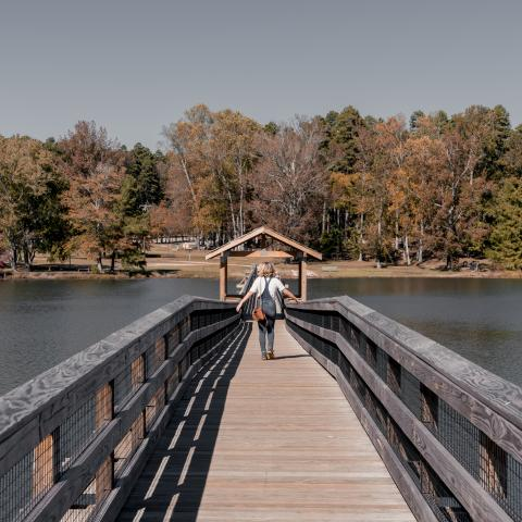 A girl walks along a bridge at Chickasaw State Park in Henderson TN