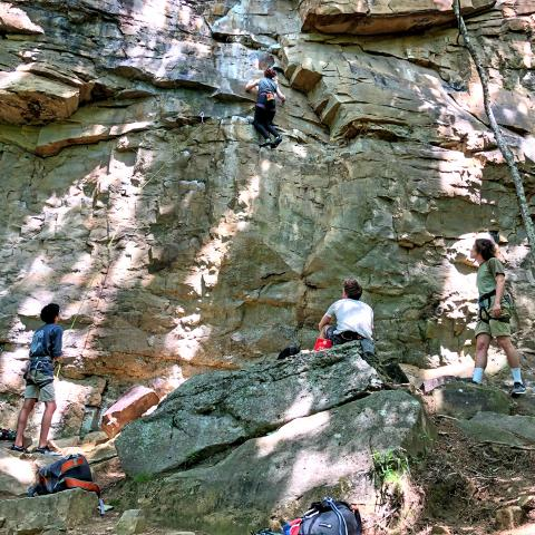 Climbers scaling rocks at Denny Cove in South Cumberland State Park