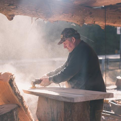 A wood artist at The Outpost in Pickwick Dam, TN