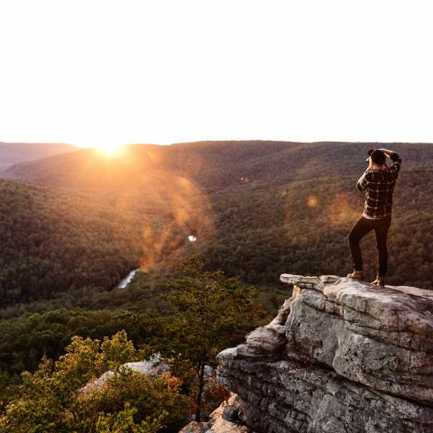 A traveler on top of Welch's Point Overlook during sunset in Sparta TN