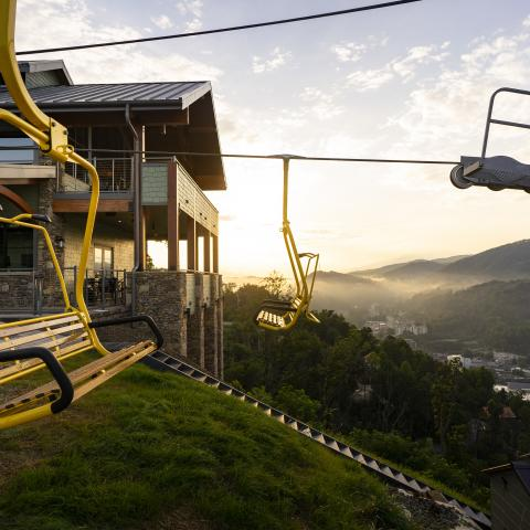 Stunning view of the iconic yellow Gatlinburg SkyLift chairs in the mountains.