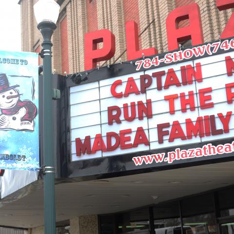 The Plaza marquee shows Captain Marvel, Run the Race, and Madea Family Funeral