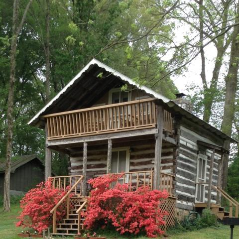 Log Cabin Bed and Breakfast in spring with azaleas in bloom