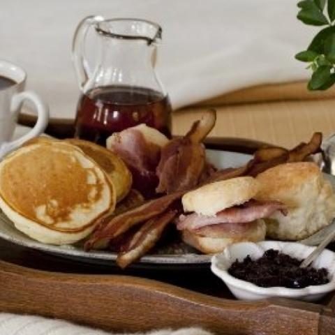 Plate of pancakes, ham and bacon