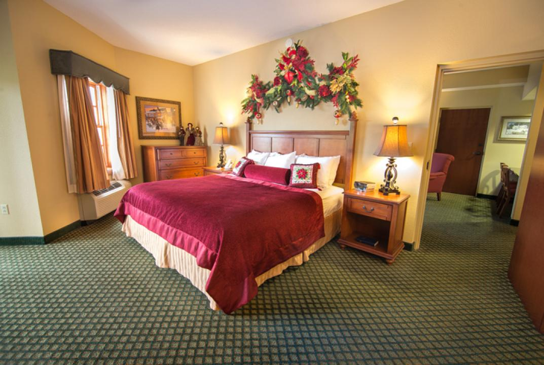 King-size bed,  bedroom of a two-room suite, The Inn at Christmas Place