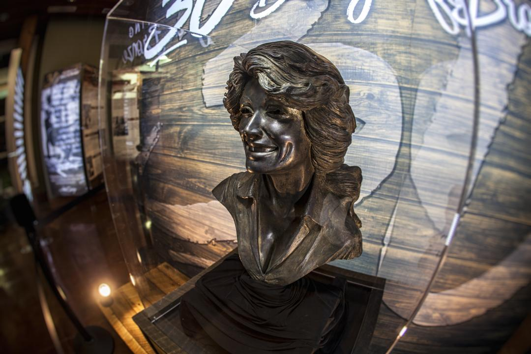 See the exhibit 30: Celebrating Dolly in Bronze at the Sevierville Visitor Center.