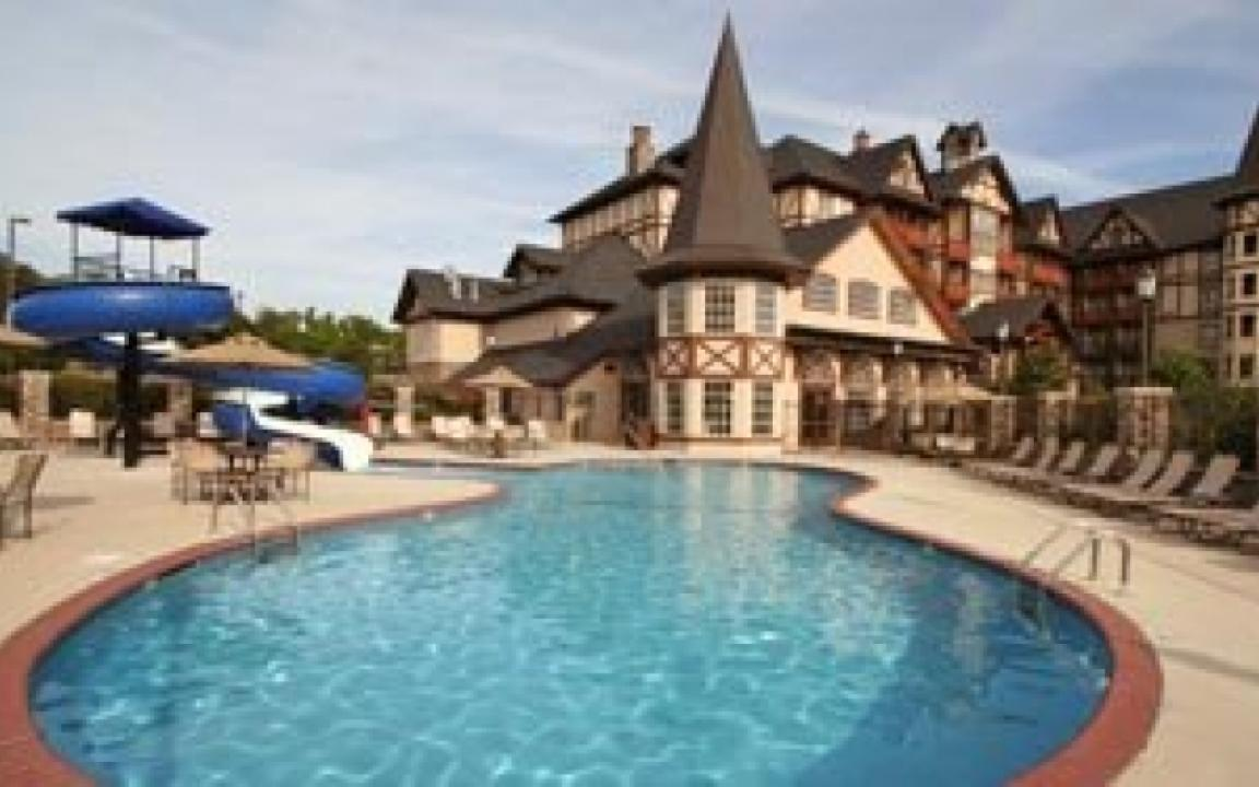 Outdoor pool with 95' figure-eight water slide and splash pad, The Inn at Christmas Place