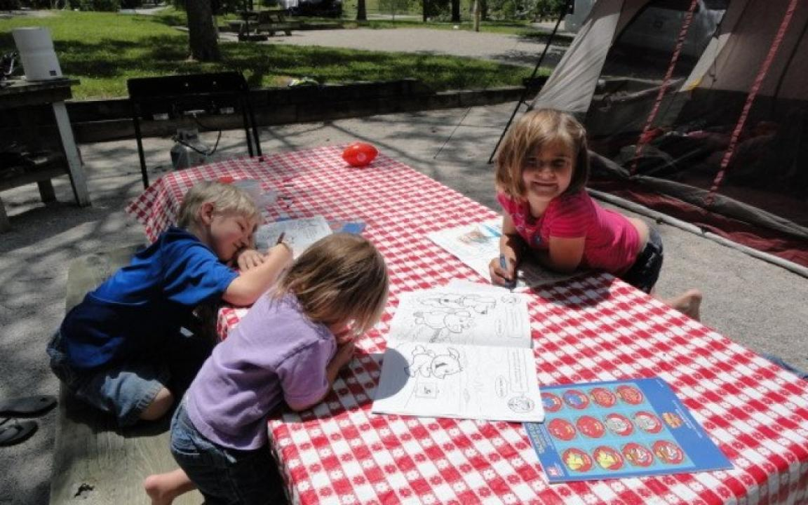 Kids coloring on a picnic table